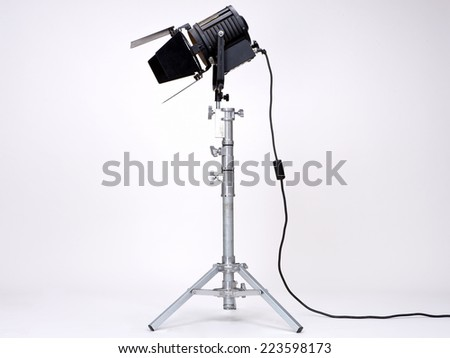 Black Movie Studio Light on a metal stand isolated on white background - stock photo