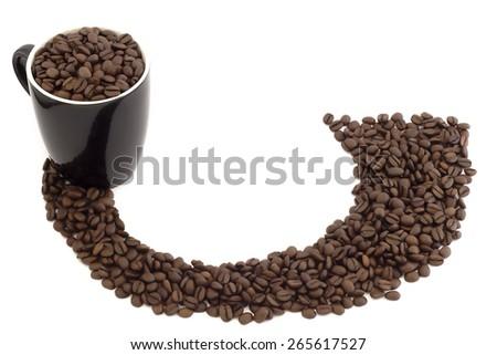 Black mug and a nice path of coffee beans - stock photo