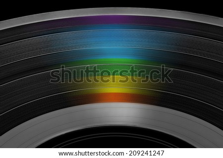 black music record with colored rainbow reflection light isolated on white background - stock photo
