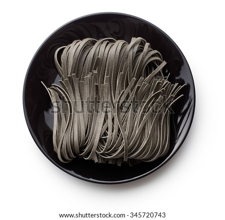 black noodles with squid sepia ink on plate - stock photo