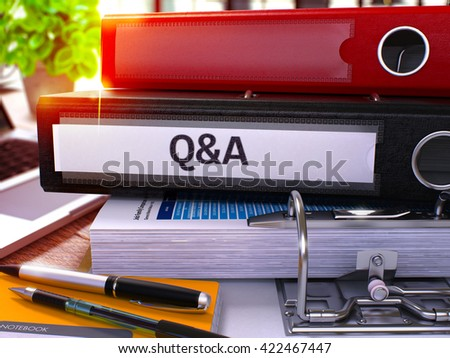 Black Office Folder with Inscription Question and Answer on Office Desktop with Office Supplies and Modern Laptop. Question and Answer Business Concept on Blurred Background. 3D. - stock photo