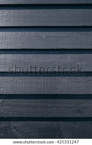 Black painted barn wood pine planks traditional norwegian siding background pattern. Space for text. lettering, copy. - stock photo