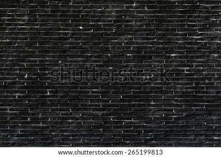 Black painted brick wall - stock photo