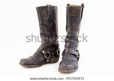black pair of vintage boots isolated on white background - stock photo