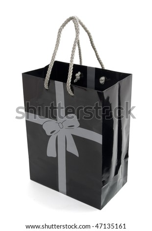 Black paper gift or shopping bag isolated on white - stock photo