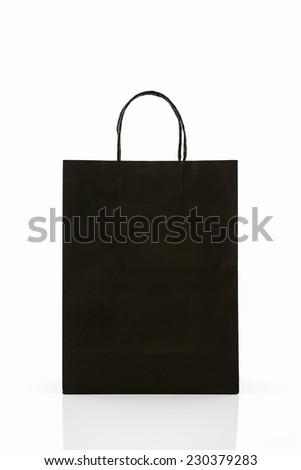 Black paper shopping bag on white background.  - stock photo