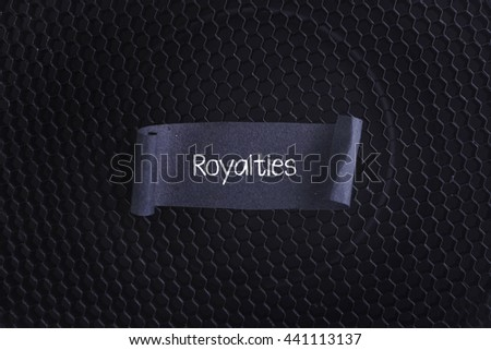 Black papper with Royalties on black texture background. - stock photo