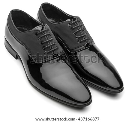 Black patent leather men shoes isolated on white background. - stock photo