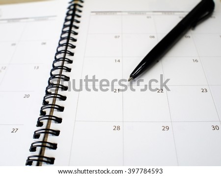 Black pen point events day on calendar notebook. - stock photo