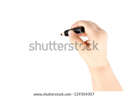 Black pencil in the hand of the child - stock photo
