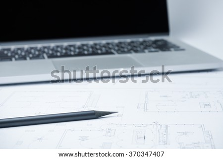 black pencil on architectural drawing paper and rolls for construction - stock photo