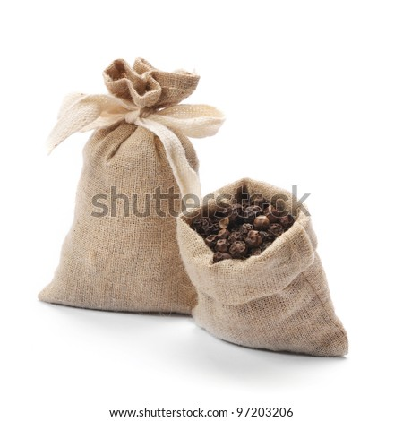 Black pepper in burlap sack - stock photo