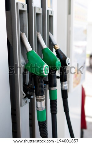 black petrol distributor - ON white - stock photo