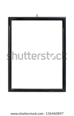 black picture frame hanging on nail, isolated on white - stock photo