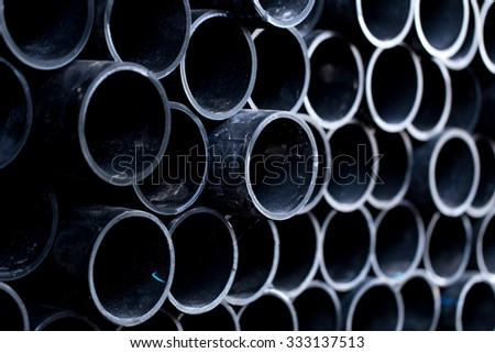 Black pipe, Rubber Water Hose, PVC Flex Pipe. - stock photo