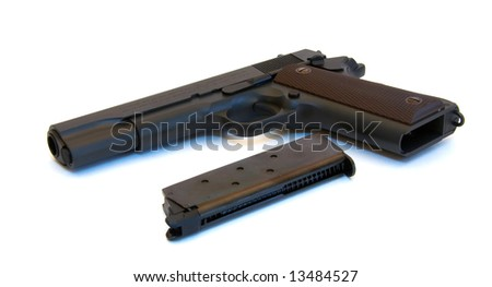 Black pistol with magazine.