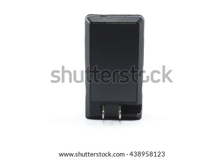 Black plastic battery charger isolated on white,digital video battery compact travel charger - stock photo