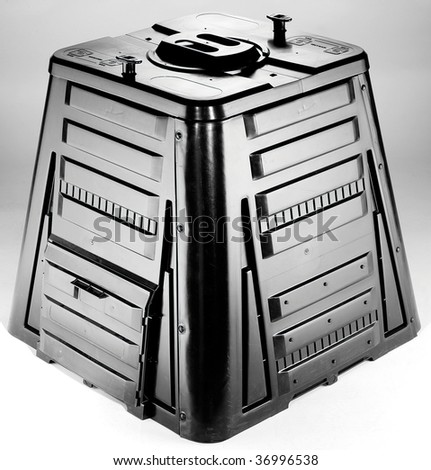 Black plastic shiny garden composter made from three pieces - stock photo