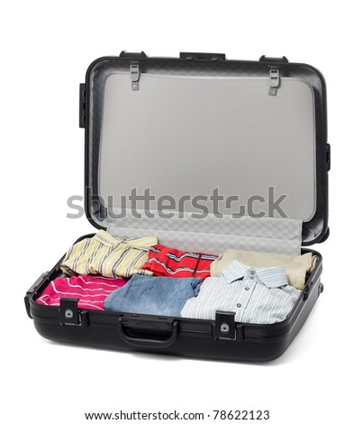 Black Plastic Suitcase with clothes - stock photo