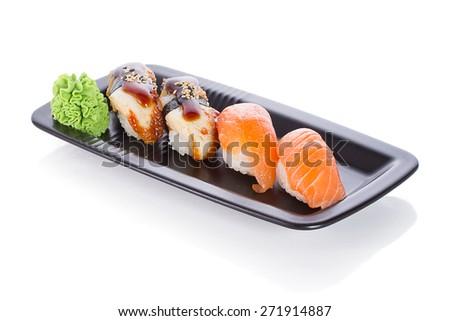 Black plate with sushi nigiri isolated - stock photo