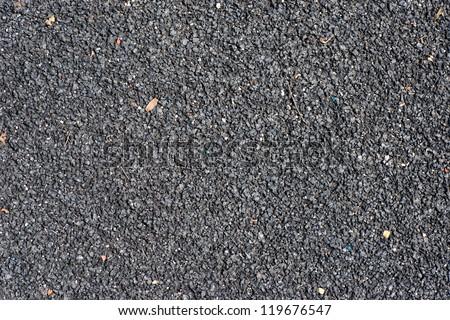 Black playground soft rubber surface - stock photo