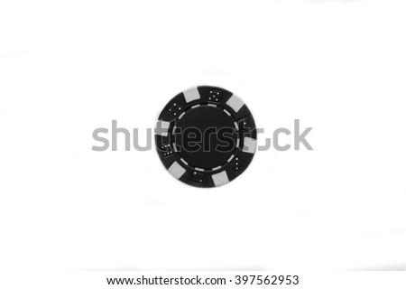 Black poker chip on a white background. Black poker chip isolated on white macro. Casino chip isolated over white background. - stock photo