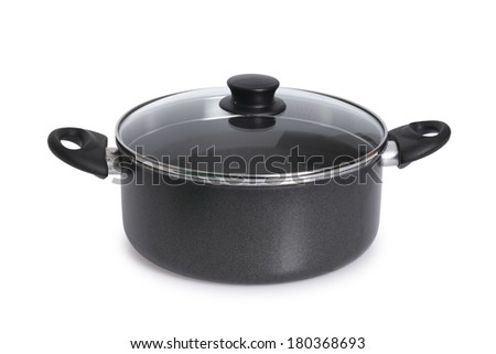black pot with glass lid on white background - stock photo