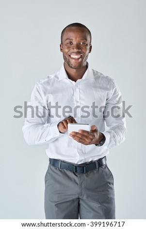 Black professional business man talking on his mobile cell phone having a conversation in studio - stock photo