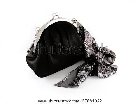 Black purse and sequin ribbon - stock photo