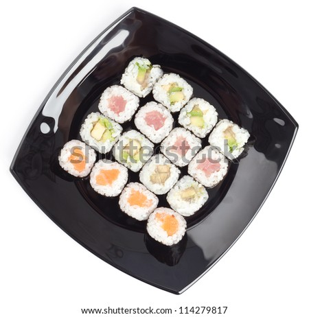 Black rectangle plate with sushi, isolated on white. Top view - stock photo