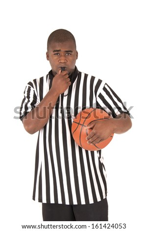 black referee blowing whistle holding a basketball - stock photo