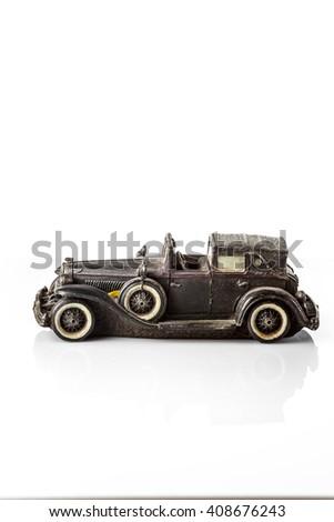 Black retro car model on a white background. - stock photo