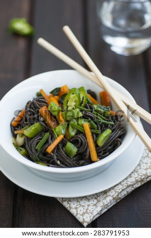 Black rice noodles with vegetables - stock photo