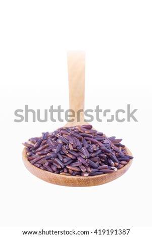 Black rice Thailand (Berry rice) in wooden spoon over white background Selective focus - stock photo