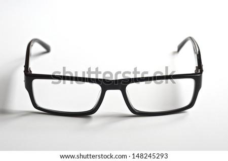 Black rimmed reading glasses on a white background - stock photo