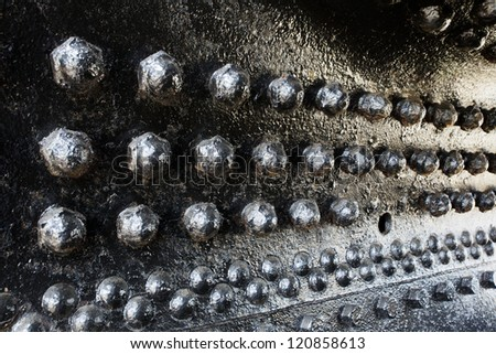 Black rivets in perspective on a train engine boiler - stock photo