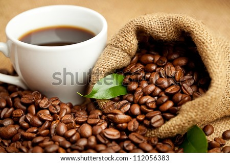black roasted arabic coffee and cup of hot drink - stock photo