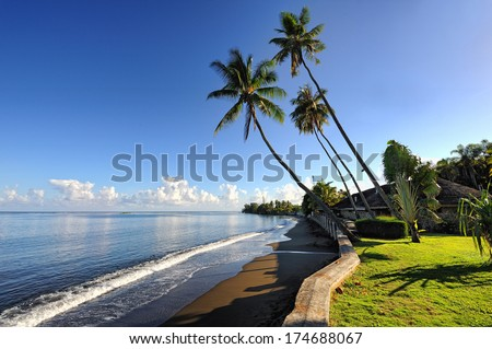 Black sand beach, Pirae, Papeete,Tahiti island, French Polynesia - stock photo