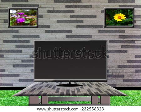 Black screen TV on the table and wall background - stock photo