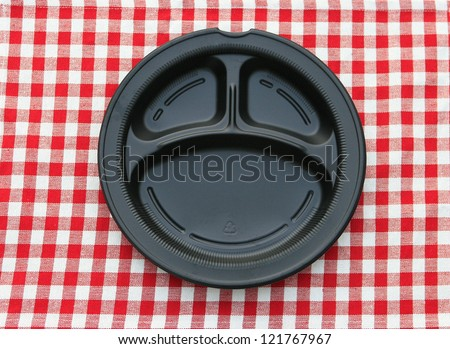 Black Serving Tray Plate on red and white checkered background - stock photo