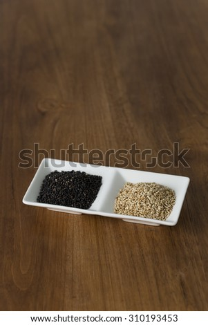 Black sesame and white sesame - stock photo