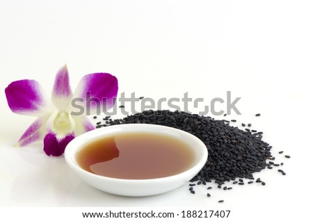 Black sesame seeds and sesame oil - stock photo