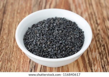 black sesame seeds in a bowl - stock photo