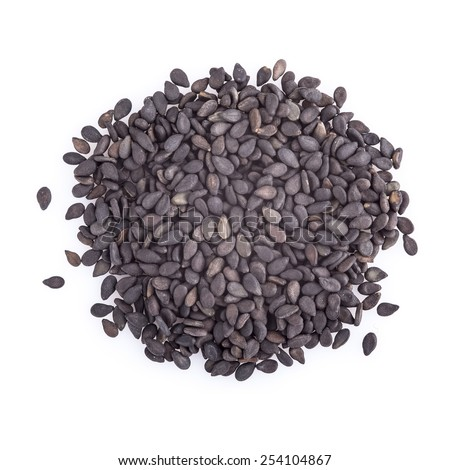 Black sesame seeds isolated on a white background - stock photo