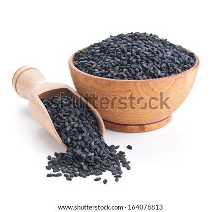 black sesame seeds isolated on white background - stock photo