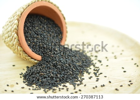 Black Sesame Seeds, It is widely naturalized in tropical regions around the world and is cultivated for its edible seeds - stock photo