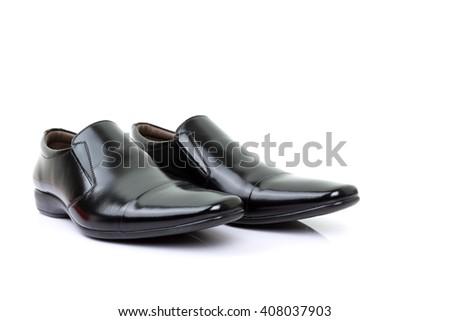 black shoes isolated on white background. - stock photo