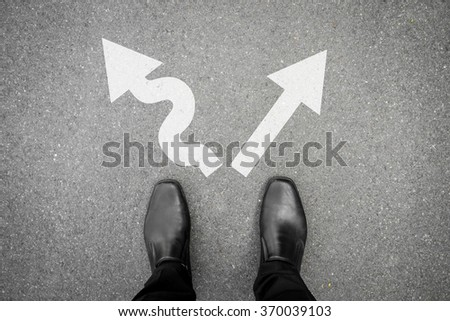 Black shoes standing at the crossroad and has to make decision which way to go for his success - hard way or easy way - stock photo