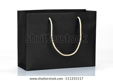 Black shopping bag on white - stock photo