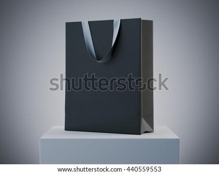 Black shopping bag on white podium in studio. 3d rendering - stock photo